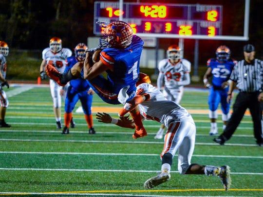 York High's Dayjure Stewart nearly flips in the air