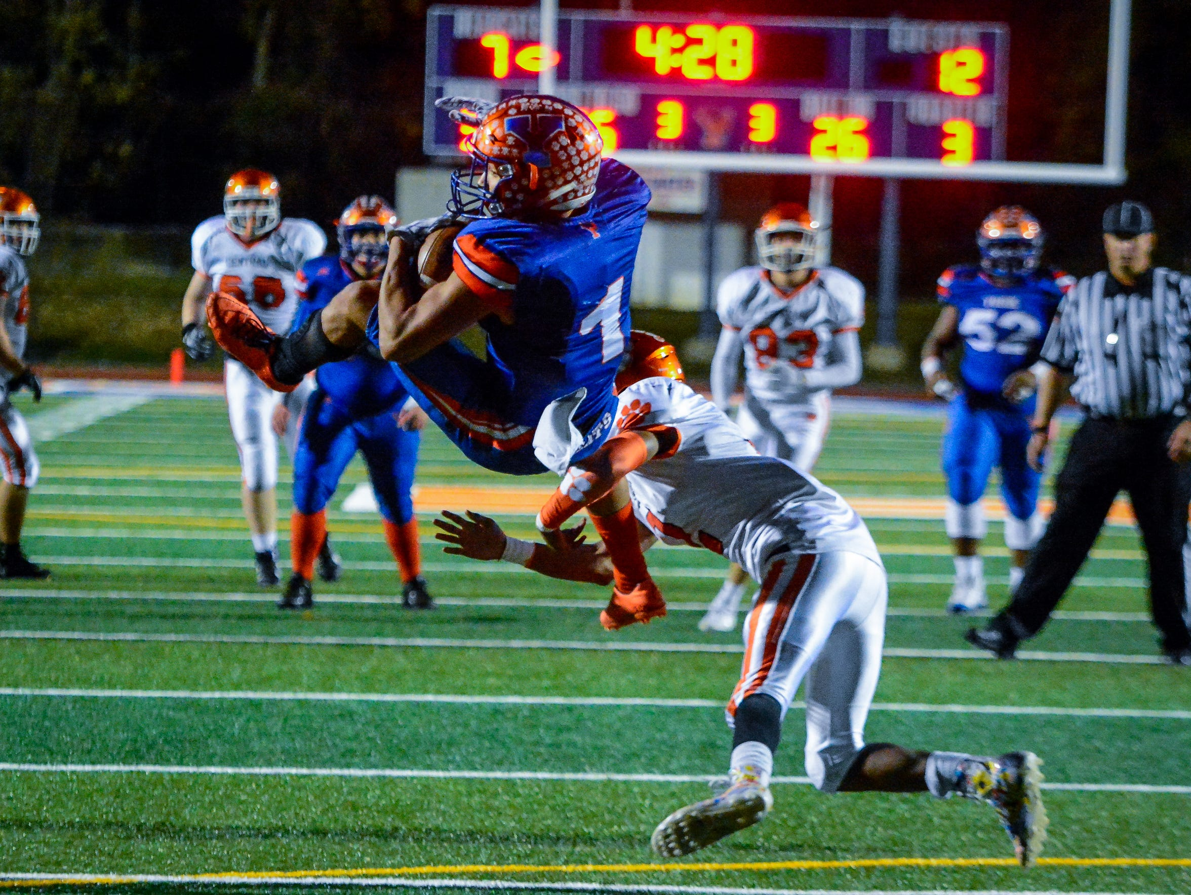 York High's Dayjure Stewart nearly flips into the end zone in a game last season. DISPATCH FILE PHOTO.