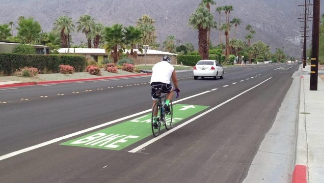 A bicyclist uses a new bike lane on Alejo Road in Palm Springs. Lanes were recently installed around the city.