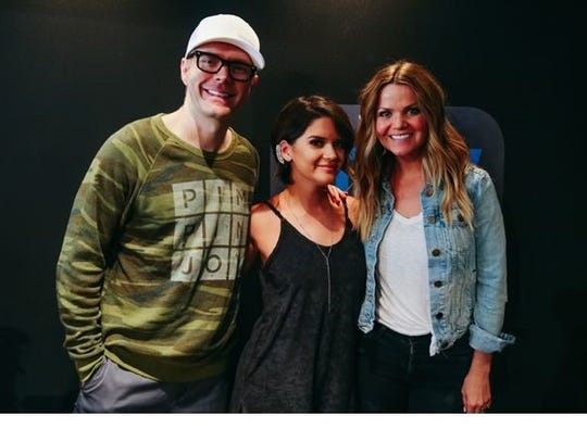 Maren Morris, surrounded by Bobby Bones and Amy Brown,