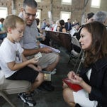 U.S. Treasurer Rosa Rios talks with John Cuddy, 5, on Monday before the start of a town hall meeting about who he thinks should be on the revamped $10 bill, in Seneca Falls, N.Y. John picked Harriet Tubman.