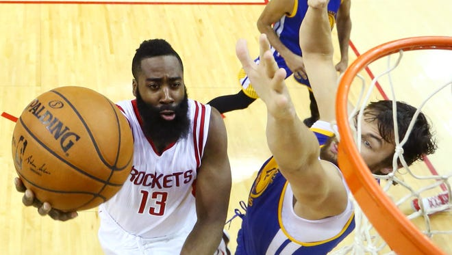 Houston Rockets guard James Harden shoots against Golden State Warriors center Andrew Bogut during the second half in Game 4.