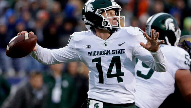 Michigan State quarterback Brian Lewerke looks to pass during the second half of MSU's 39-31 triple-overtime loss on Saturday, Oct. 28, 2017, in Evanston, Ill.