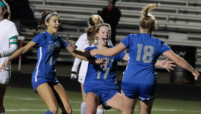 Teammates rush to Maddie Brault (18) after she puts Summit on the board with a goal.  Summit Country Day moves past Grandview Heights in the Girls State Semi-finals a Beavercreek High School on Tuesday, November 7, 2017.
