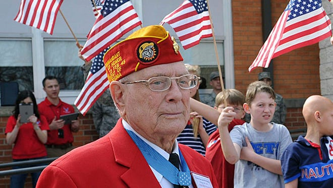 """In this Feb. 19, 2016, file photo, Hershel """"Woody"""" Williams waits for other members of the Iwo Jima Survivors Association to arrive at Sheppard Elementary in Wichita Falls, Texas. The NFL will salute 15 recipients of the Medal of Honor, the United States' most prestigious military decoration, when they participate in the coin toss before Super Bowl 52 on Feb. 4, 2018, in Minneapolis. Williams, who received the Medal of Honor during the Battle of Iwo Jima, will flip the coin, surrounded by the group of recipients."""