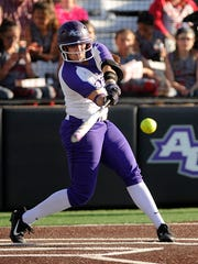 Abilene Christian's Holly Neese (24) hits a ball during the bottom of the third inning of the Wildcats' 6-2 win over North Texas on Wednesday, April 19, 2017, at ACU's Poly Wells Field.