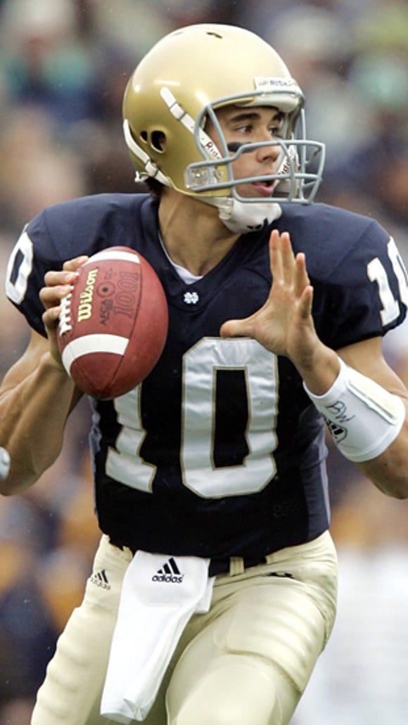Former Notre Dame quarterback Brady Quinn works for