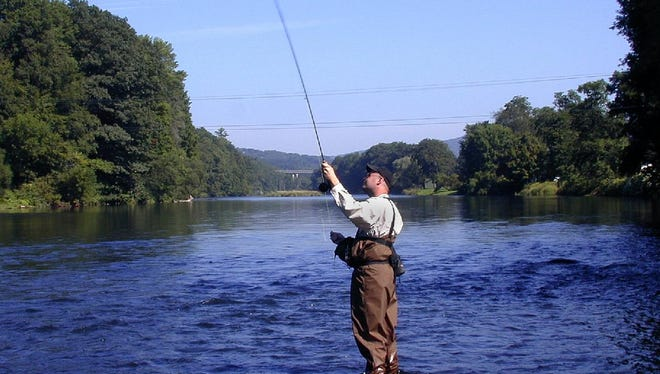 David Rossie took this photo in 2003 of a man fly fishing on the West Branch of the Deleware River near Deposit.