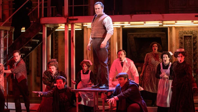 "Andrew Varela (center, standing) portrays the title character in Skylight Music Theatre's ""Sweeney Todd."""