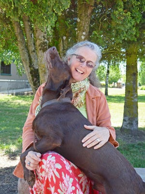 Willamette Human Society Executive Director BJ Andersen, pictured her with her dog, Luke, earned top credentials.
