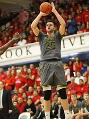 Vermont's Drew Urquhart shoots during the Catamounts'