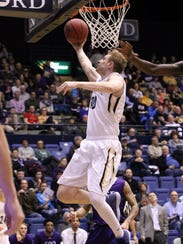 Marcus Asmus of Augustana lays up a shot during Friday