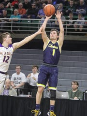 Clarkston guard Foster Loyer shoots against Warren De La Salle guard Easton Sikorski on Friday.