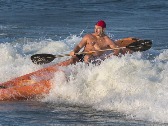 Eric Roberts of Manasquan heads for a first-place win in the kayak relay at the Spring Lake Lifeguard Tournament on Thursday July 21, 2016.