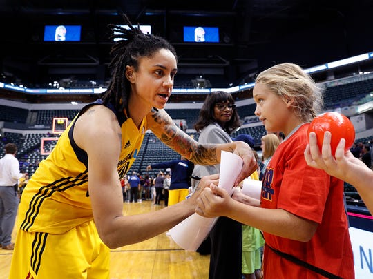 Indiana Fever forward Candice Dupree (4) signs autographs for fans following their game against the San Antonio Stars at Bankers Life Fieldhouse, September 2, 2017.