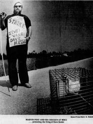 A News-Press photo of a protester delivering a chicken