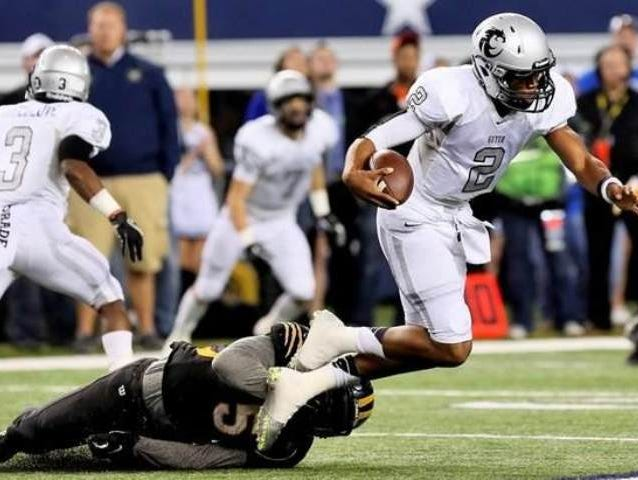 Denton Guyer quarterback Jerrod Heard is tripped up by a Brennan defender in the Wildcats' 31-14 win over the Bears in the 4A Division I state final in 2013 at AT&T Stadium.
