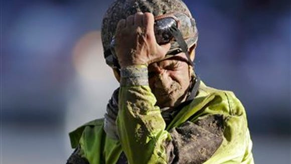 Javier Castellano takes off his goggles after riding