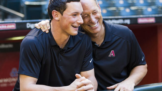 Former Arizona Diamondbacks player Luis Gonzalez (right) and his son Jacob share a laugh at Chase Field in Phoenix, Ariz. May 22, 2017. Jacob will be entering in this year's MLB draft.