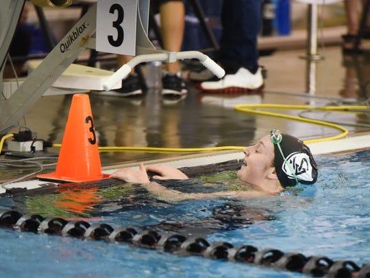 Salem Academy junior Kiera Supple celebrates winning the state championship in the 100 backstroke on Saturday, Feb. 21, 2015.