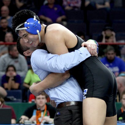 Cliffton Wang of Edgemont is hugged by coach Pete Jacobson