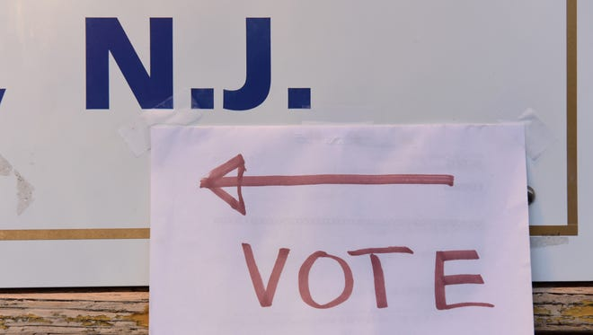 A sign on the front of the building guiding voters to the polling area at the American Legion Post 128 in Teaneck Tuesday morning.