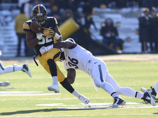 Iowa wide receiver Adrian Falconer, left, is a player to watch going into the offseason for the Hawkeyes.