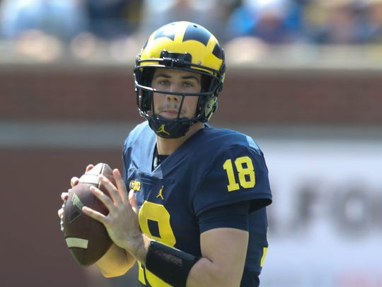 Michigan quarterback Brandon Peters takes part in the
