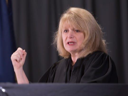 Judge Laura Mack.