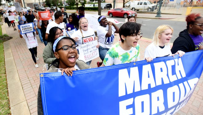 Tifphany McClinton, left, Ashford McLain, Allison Huffy and Mau'Tisse Jackson lead the march during the March for Our Lives event  at the Caddo Parish Courthouse in Shreveport, La.