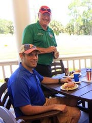 Indian River County Administrator Jason Brown, seated,