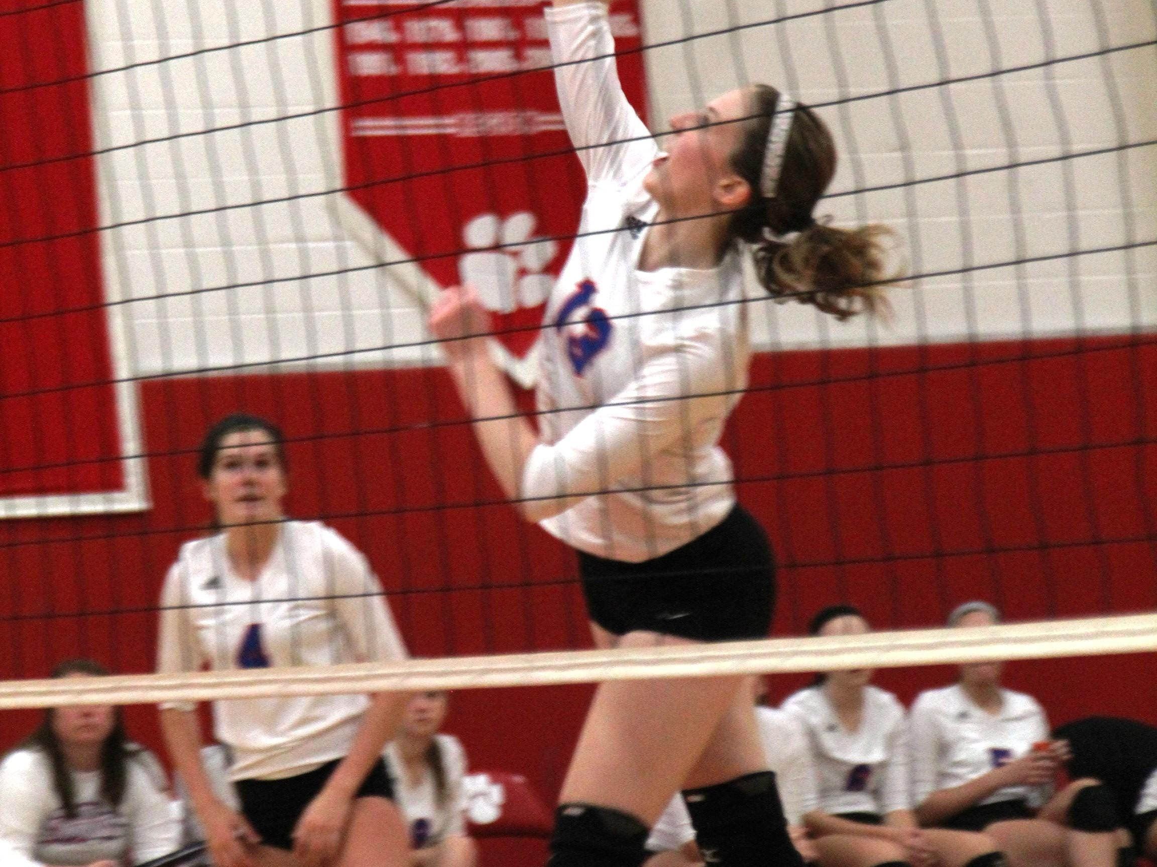 Conner's Cali Helinski hits the ball. Conner played at Beechwood in volleyball Sept. 24, 2014.