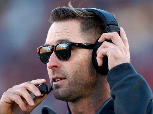 FILE - In this Nov. 19, 2016, file photo, Texas Tech coach Kliff Kingsbury watches from the sideline during the first half of the team's NCAA college football game against Iowa State in Ames, Iowa. Kingsbury is in year four at his alma mater in heading toward a second season with no bowl game. A $9 million buyout means it is highly unlikely that he will be fired, but ending the season with a victory Friday night against fading Baylor (6-4) in Lubbock, Texas, would provide a little hope for a fanbase that is growing weary of the defenseless Red Raiders. (AP Photo/Charlie Neibergall, File)