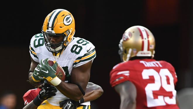 Green Bay Packers tight end Jared Cook (89) runs with the football against San Francisco 49ers strong safety Jaquiski Tartt (29) during the first quarter at Levi's Stadium.