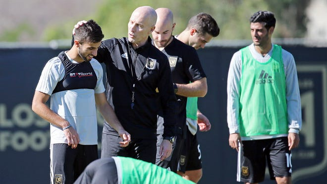 Coach Bob Bradley talks with Diego Rossi (left) during the introduction of players and coaches at the first training camp of the Los Angeles Football Club on the campus of UCLA.