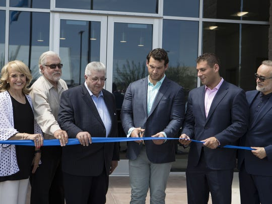 Former Gov.Jan Brewer, Glendale Mayor Jerry Weiers and Conair executives cut the ribbon to the new Conair distribution center on Aug. 1, 2017, in Glendale.