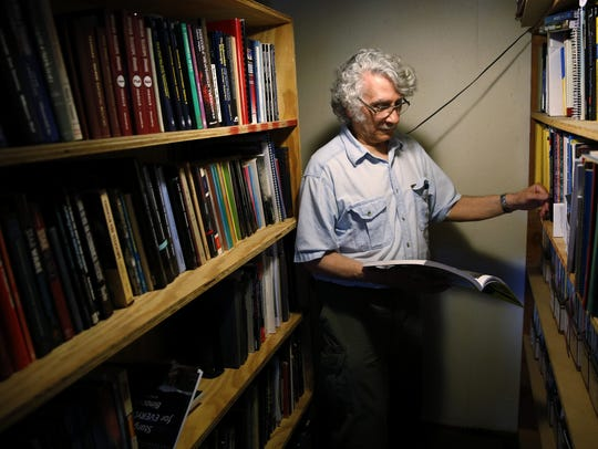 Richard Berry holds one of the many books he has written