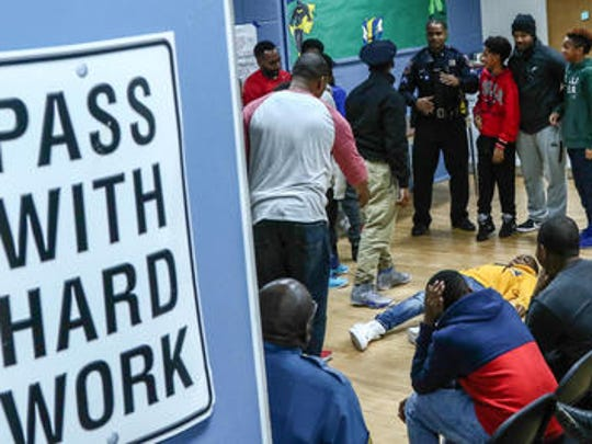 Wilmington police Cpl. Brian Alleyne oversees a shooting scene scenario performed by youth in front a audience during the Just(ice) In Time Training Seminar Jan. 19, 2017, at Clarence Fraim Boys & Girls Club in Wilmington.