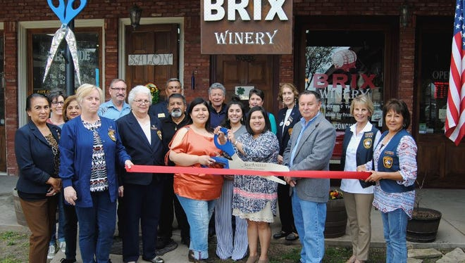 Members of the San Angelo Chamber of Commerce, the Concho Cadre, and City Councilman Harry Thomas celebrated with sisters Adriana Romo and Esmeralda Dominguez the grand opening of Brix Winery, 113 E. Concho Ave., Ste. 190, on March 9.