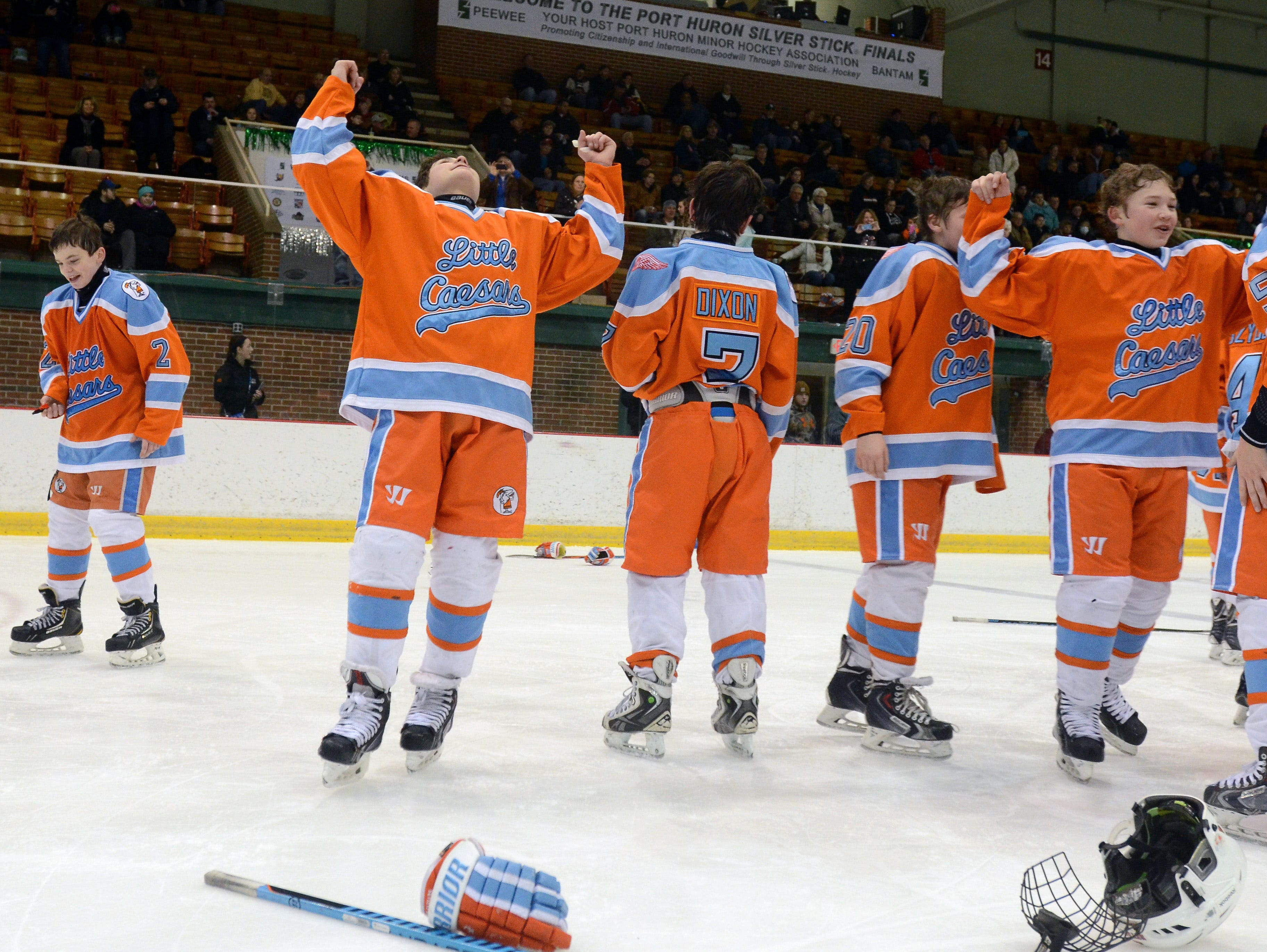 Members of the Detroit Little Caesars celebrate Sunday, Jan 11 after winning the PeeWee AAA Silver Stick Finals championship game.