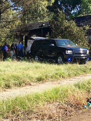 A body with a gunshot wound was found in a burning out house in Jackson, Miss.