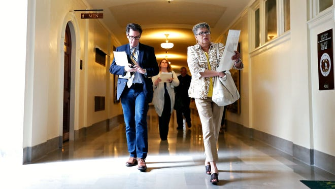 Rev. Mark Struckhoff (left), executive director of the Council of Churches of the Ozarks, Rev. Emily Bowen-Marler (middle) of Brentwood Christian Church and Cheryl Clay, Springfield NAACP president, walk towards Rep. Charlie Norr's office during a lobby day at the Missouri State Capitol in Jefferson City, Mo. on April 20, 2016 aimed at convincing lawmakers to reject campaign donations by payday loan companies.