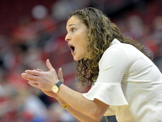 Marquette head coach Carolyn Kieger talks to her team during the first half of a first-round game in the NCAA women's college basketball tournament in Louisville, Ky., Friday, March 16, 2018. (AP Photo/Timothy D. Easley)