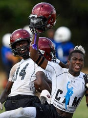 Prattville celebrates advancing during the Cam Newton Foundation 7 on 7 football tournament at Prattville High School in Prattville, Ala. on Saturday July 1, 2017.