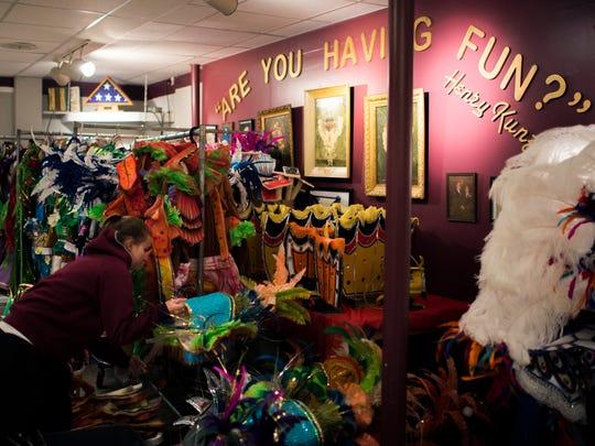 Pennsauken High School student Megan Flaherty, 16, sorts through costumes inside the Duffy String Band headquarters Thursday in Philadelphia.