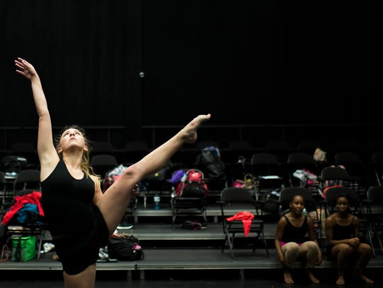 """Casey Byrne, 17, rehearses during a """"That Which Connects''"""