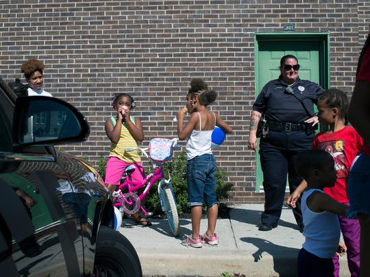 Children enjoy ice cream during a Cops, Kids and Cones event Thursday, August 24, 2017 at Oakview Apartments in Millville.