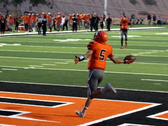 El Paso High receiver Johny Avila celebrates a long