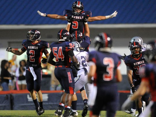 West's Nathan Cottrell (5) is hoisted by teammates