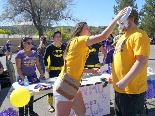 ASWNMU Senator Sheila Menezes throws a pie  at ASWNMU